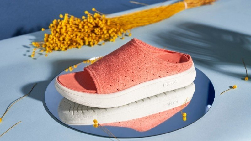 Sustainable sandals from Munjoi is bright coral