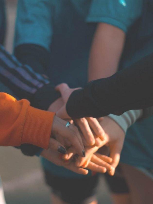 Stacking hands together