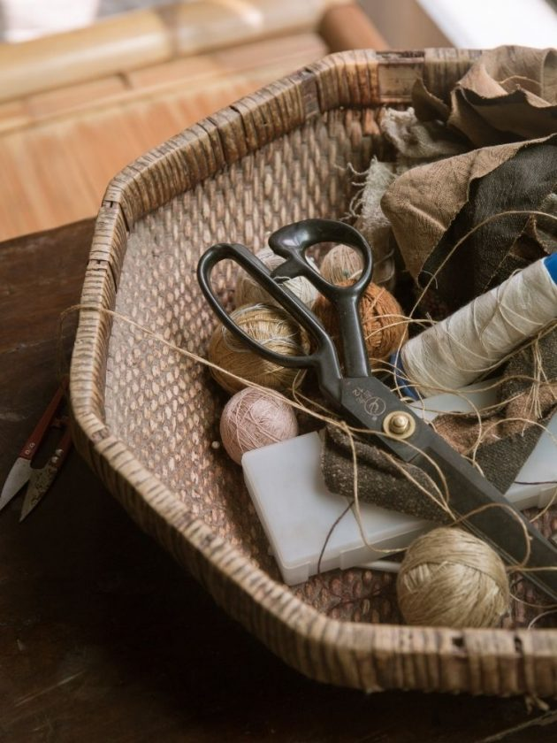 Scissors and thread in a basket for clothing repair or mending