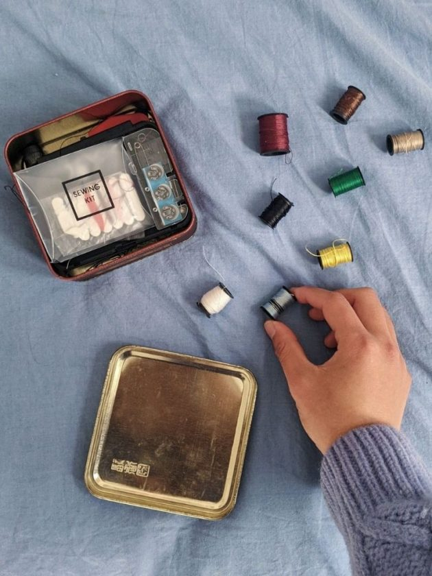 Lily with a sewing kit